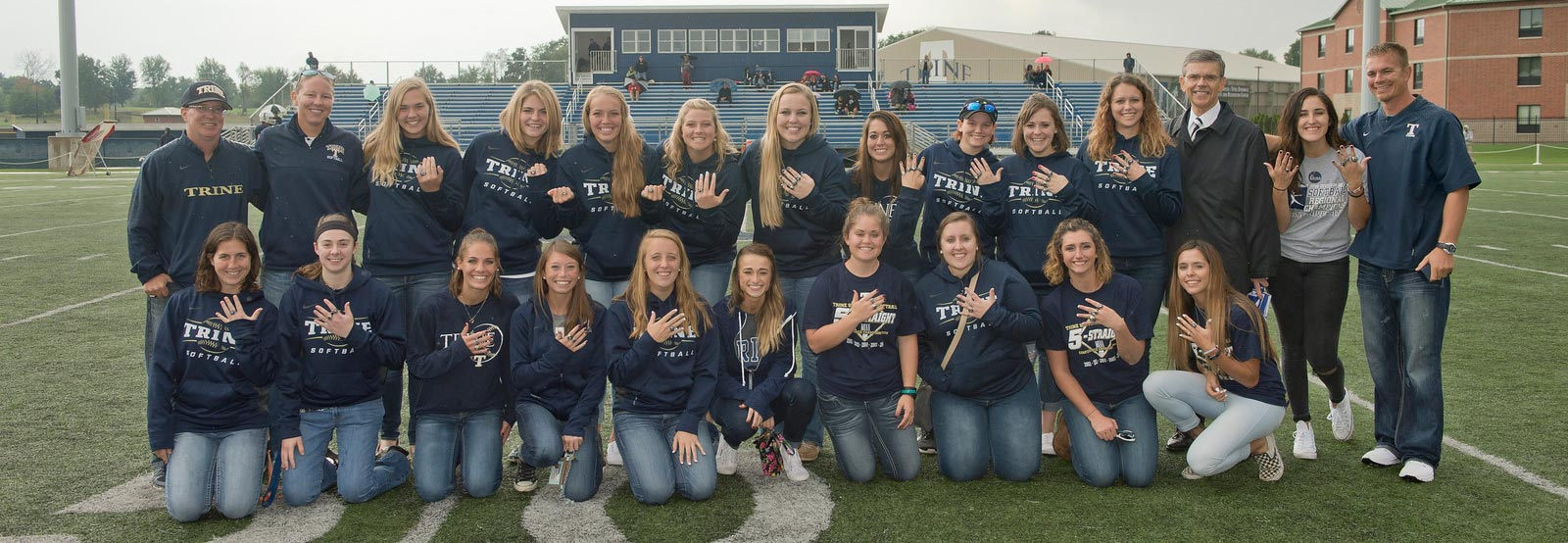 Softball team showing off rings