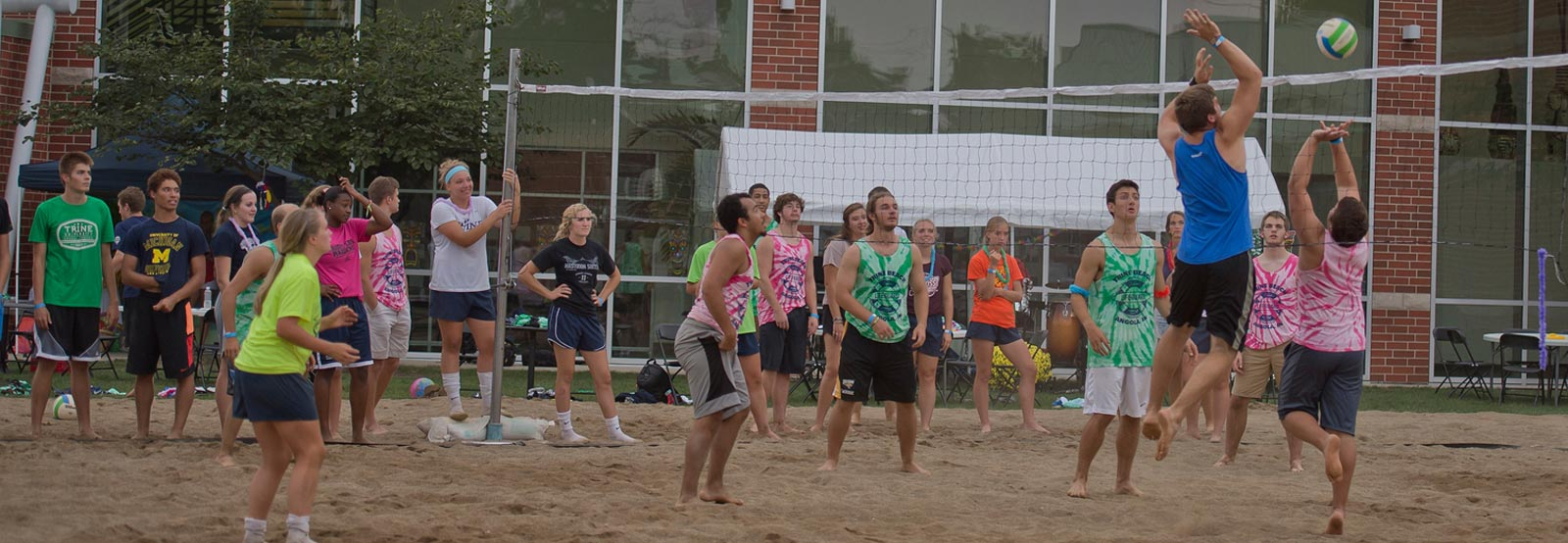 Students playing volleyball outside